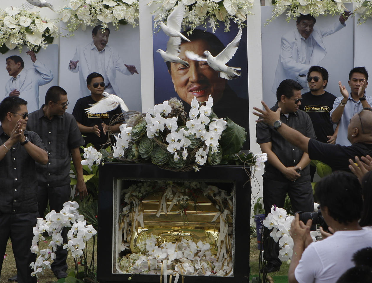 "Doves fly over the tomb of the country's ""King of Comedy"", Rodolfo Vera Quizon Sr., locally known as ""Dolphy"", during funeral rites at a cemetery in Taguig, south of Manila, Philippines on Sunday July 15, 2012. Quizon starred in more than 200 films in his 66-year career. The 83-year-old died Tuesday of multiple organ failure, kidney ailments and complications from pneumonia.(AP Photo/Aaron Favila)"