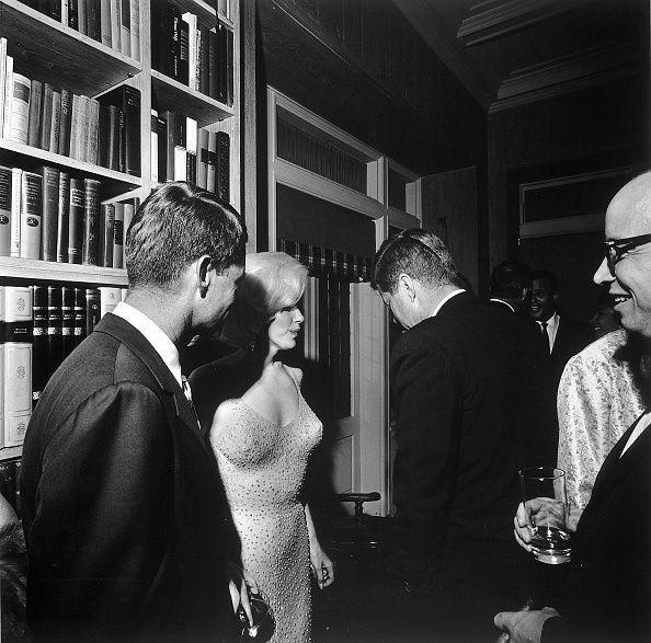 "<p>Marilyn Monroe standing between Robert Kennedy (L) and President John F. Kennedy, following Monroe's famous rendition of ""Happy Birthday"" at Madison Square Garden. </p>"