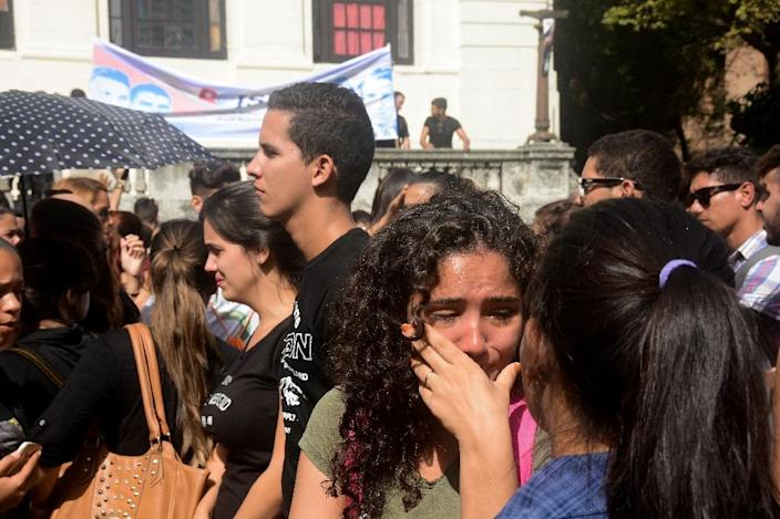 A university student cries during a gathering in Havana on November 26, 2016, the day after Cuban historic revolutionary leader Fidel Castro died aged 90 (AFP Photo/STR)