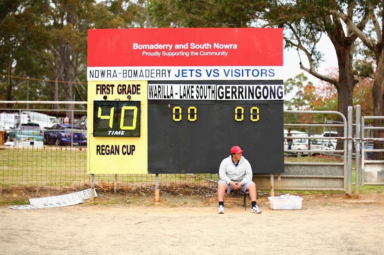 NOWRA, AUSTRALIA - SEPTEMBER 22: The scoreboard attendant waits for the start of the Country Rugby League South Coast Group 7 Grand Final match between the Warilla Lake South Gorillas and the Gerringong Lions at Nowra Showgrounds on September 22, 2013 in Nowra, Australia. (Photo by Mark Kolbe/Getty Images)
