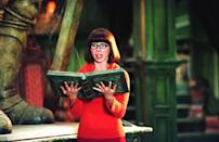 <p>Another simple character to dress as with your bob wig is Velma. Her orange and red outfit is easy to replicate. Plus, the sweater is perfect for the fall weather - just don't forget the glasses.</p>