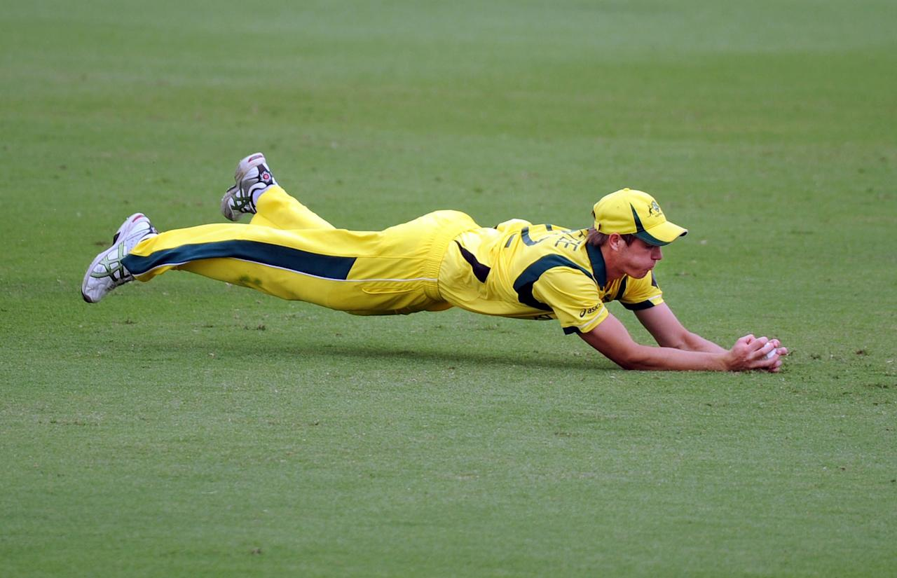 TOWNSVILLE, AUSTRALIA - AUGUST 21:  Mark Steketee of Australia dives forward to take a catch to dismiss Calvin Savage of South Africa during the ICC U19 Cricket World Cup 2012 Semi Final match between Australia and South Africa at Tony Ireland Stadium on August 21, 2012 in Townsville, Australia.  (Photo by Malcolm Fairclough-ICC/Getty Images)