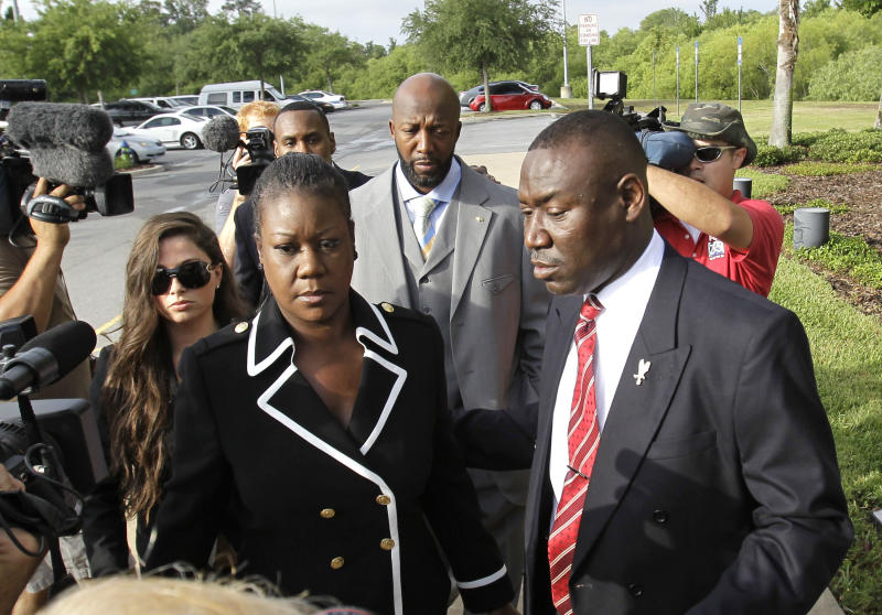 Sybrina Fulton, front left, Tracy Martin, center, parents of Trayvon Martin, and attorney Benjamin Crump, front right, arrive at the Seminole County Criminal Justice Center for a bond hearing for George Zimmerman, the neighborhood watch volunteer charged with murdering Trayvon Martin, Friday, April 20, 2012, in Sanford, Fla. Attorney for Zimmerman, Mark O'Mara is asking the Seminole County judge to let Zimmerman post bail at the hearing Friday. (AP Photo/John Raoux)