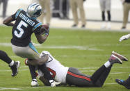 Carolina Panthers quarterback Teddy Bridgewater, left, is sacked by Tampa Bay Buccaneers outside linebacker Jason Pierre-Paul, right, during fourth-quarter NFL football game action in Charlotte, N.C., Sunday, Nov. 15, 2020. (Jeff Siner/The Charlotte Observer via AP)