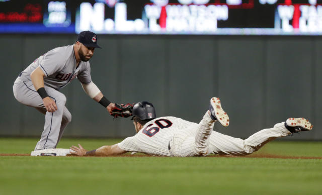 Minnesota Twins Jake Cave (60) advances to second as Cleveland Indians second baseman Jason Kipnis tries to make the tag after a fly-out by Bobby Wilson during the seventh inning of a baseball game Tuesday, July 31, 2018, in Minneapolis. The Indians defeated the Twins 6-2. (AP Photo/Andy Clayton-King)
