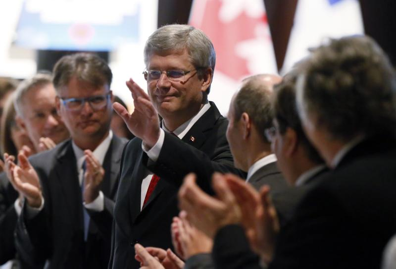 Canadian Prime Minister Stephen Harper waves as arrives for a luncheon speech to the Montreal Board of Trade in Montreal