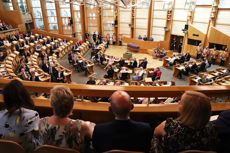 Queen Elizabeth II, the Duke of Rothesay and MSPs listen to performers during a ceremony marking the 20th anniversary of devolution in the Holyrood chamber at the Scottish Parliament in Edinburgh, Scotland.