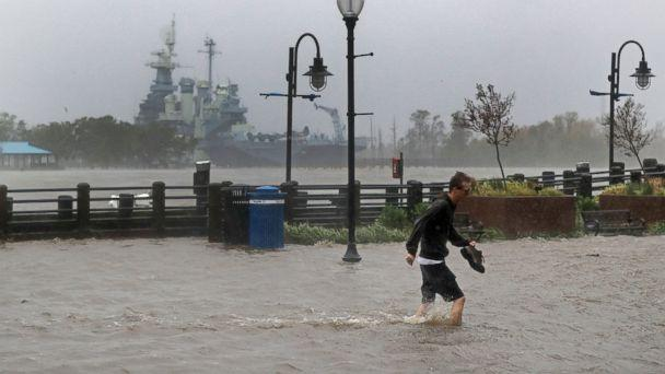 PHOTO: A man crosses a flooded street in downtown Wilmington, N.C., after Hurricane Florence made landfall Friday, Sept. 14, 2018. (AP)