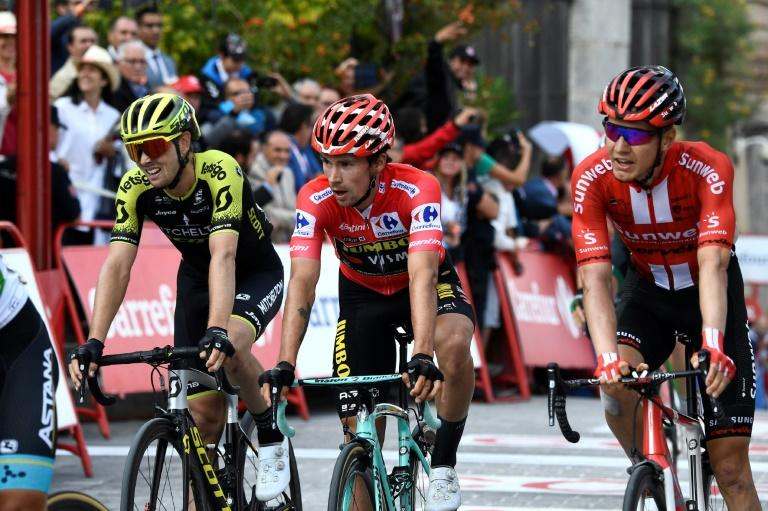 Despite falling Primoz Roglic rolled across the finish line in Toledo, his lead intact