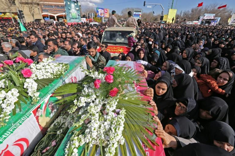 """Tens of thousands of mourners attended the funerals of the Revolutionary Guards in the central Iranian city of Isfahan, with many calling for """"revenge"""""""
