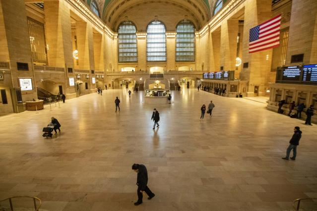 People make their way inside a near-empty Grand Central Terminal in New York. (AP)