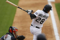 Colorado Rockies' Nolan Arenado doubles off Houston Astros relief pitcher Brooks Raley in the fifth inning of a baseball game Thursday, Aug. 20, 2020, in Denver. (AP Photo/David Zalubowski)