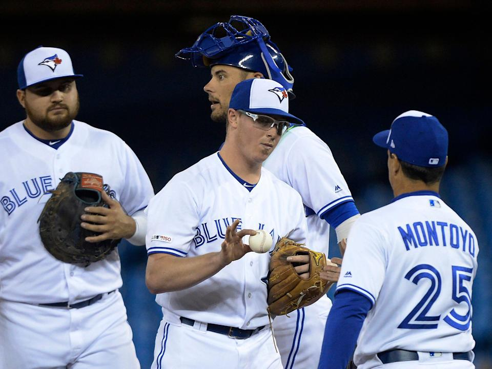 Toronto Blue Jays starting pitcher Trent Thornton (57) hands the ball to manager Charlie Montoyo as he is taken out during the third inning of a baseball game against the Minnesota Twins, Wednesday, May 8, 2019, in Toronto. (Nathan Denette/The Canadian Press via AP)