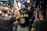 San Diego Padres' Eric Hosmer celebrates in the dugout after his three-run home run during the fourth inning of the team's baseball game against the Washington Nationals, Sunday, July 18, 2021, in Washington. (AP Photo/Nick Wass)
