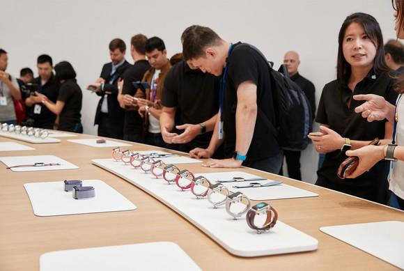 A line up of Apple Watches.
