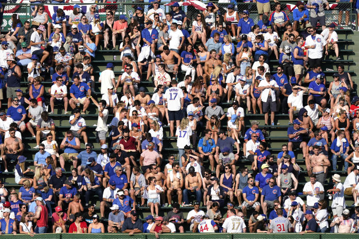 Fans wait for a baseball game between the St. Louis Cardinals and the Chicago Cubs in Chicago, Saturday, June 12, 2021. (AP Photo/Nam Y. Huh)