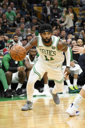 BOSTON, MA - SEPTEMBER 30: Kyrie Irving #11 of the Boston Celtics handles the ball against the Charlotte Hornets during a preseason game on September 30, 2018 at the TD Garden in Boston, Massachusetts. (Photo by Brian Babineau/NBAE via Getty Images)