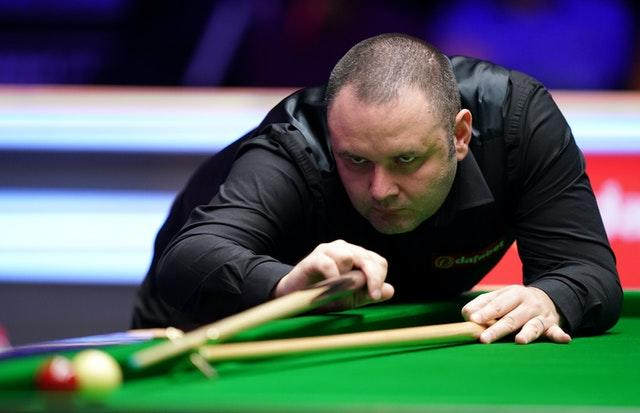 Stephen Maguire, pictured, awaits Judd Trump in the last four in Milton Keynes