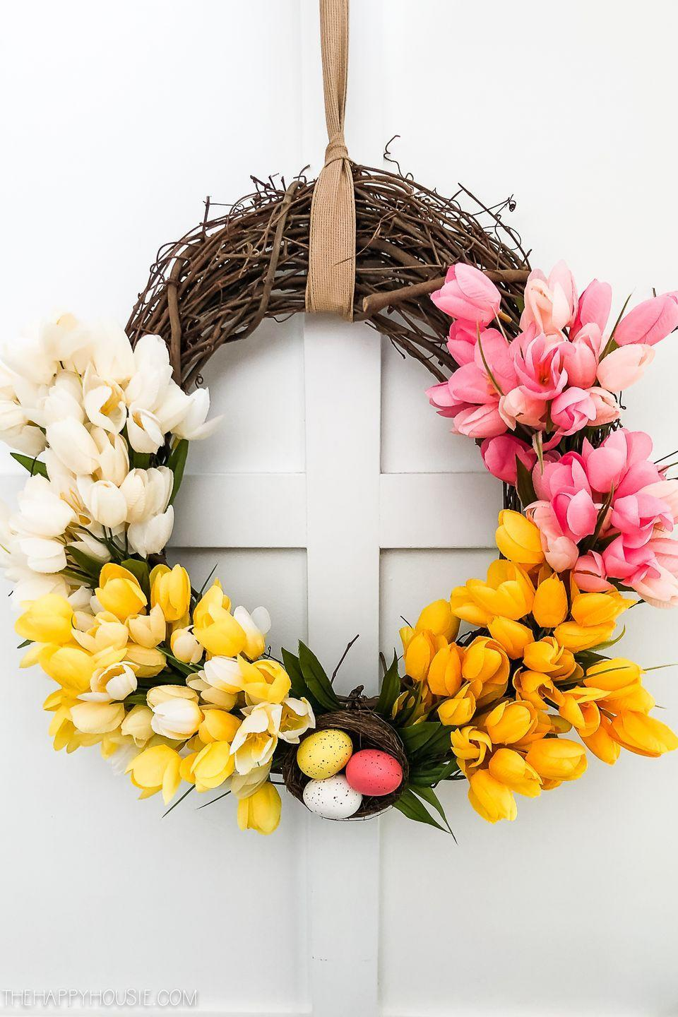 """<p>Now that it's spring, tulips have begun bursting into bloom. You can celebrate their return with a wreath covered in them! This one has a gorgeous ombré look that's truly eye-catching and takes mere minutes to make.</p><p><strong>Get the tutorial at <a href=""""https://thehappyhousie.porch.com/ombre-tulip-spring-easter-wreath/"""" rel=""""nofollow noopener"""" target=""""_blank"""" data-ylk=""""slk:The Happy Housie"""" class=""""link rapid-noclick-resp"""">The Happy Housie</a>.</strong></p><p><a class=""""link rapid-noclick-resp"""" href=""""https://go.redirectingat.com?id=74968X1596630&url=https%3A%2F%2Fwww.walmart.com%2Fip%2FAdTech-Crystal-Clear-Hot-Glue-Gun-Full-Size-Sticks-W220-1410-10-pieces-Length-4-Diameter-44%2F22217933&sref=https%3A%2F%2Fwww.thepioneerwoman.com%2Fhome-lifestyle%2Fcrafts-diy%2Fg35698457%2Fdiy-easter-wreath-ideas%2F"""" rel=""""nofollow noopener"""" target=""""_blank"""" data-ylk=""""slk:SHOP HOT GLUE"""">SHOP HOT GLUE</a></p>"""