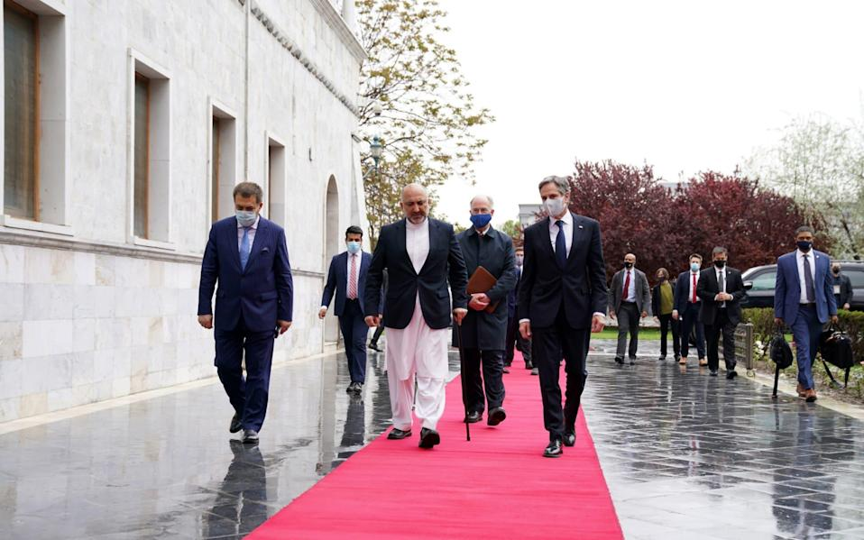 Editorial use only. HANDOUT /NO SALES Mandatory Credit: Photo by PRESIDENTIAL PALACE HANDOUT/EPA-EFE/Shutterstock (11860161f) A handout photo made available by the Presidential Palace shows U.S. Secretary of State Antony Blinken (C-R), walking with Afghanistan's Foreign Minister Mohammad Hanif Atmar (C-L), at the presidential palace in Kabul, Afghanistan, 15 April 2021