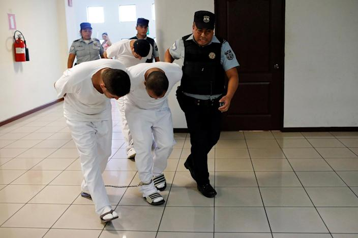 Image: Three former police officers are taken to a hearing as they face charges for aggravated homicide and the kidnapping of Camila Diaz Cordova, a transgender woman under their custody (Jose Cabezas / Reuters file)