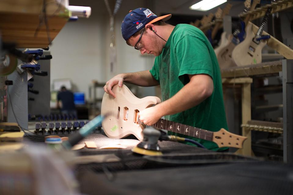A worker on the Paul Reed Smith factory floor works on a guitar. (Picture: Paul Reed Smith)