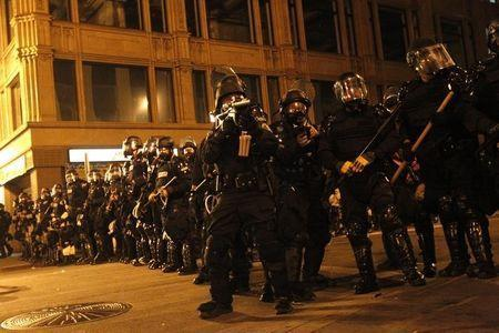 Police officers in riot gear form a line at the Occupy Oakland demonstration in Oakland, California, November 3, 2011. REUTERS/ Stephen Lam