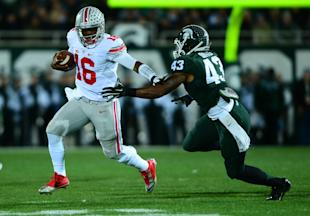 Buckeyes QB J.T. Barrett (16) runs away from Spartans LB Ed Davis. (USA TODAY Sports)