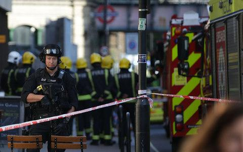 A firearms officer at the police cordon in west London - Credit: DANIEL LEAL-OLIVAS/AFP