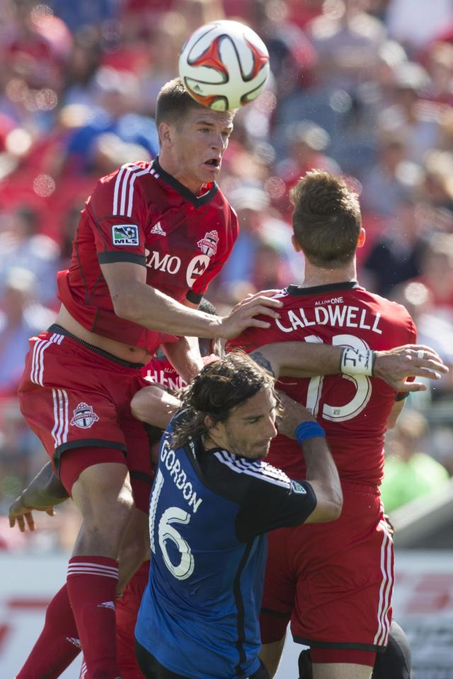 Toronto FC's Nick Hagglund, left, competes for a header with San Jose Earthquakes' Alan Gordon, center, and Toronto's Steven Caldwell during first half MLS action in Toronto on Saturday June 7, 2014. (AP Photo/The Canadian Press, Chris Young)