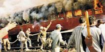 A train was set on fire by a Muslim mob in Godhra on February 27, 2002. As many as 59 Hindu kar sevaks returning from Ayodhya were burnt alive in the fire and this triggered the deadly Hindu-Muslim riots Gujarat. AP Photo/Stringer