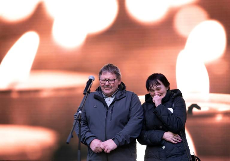 Kuciak's parents Jozef and Jana Kuciak address the memorial crowd on Friday (AFP Photo/JOE KLAMAR)