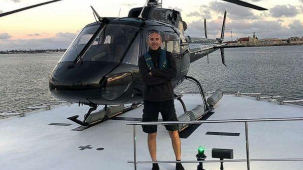 PHOTO: A photo released by Group 3 Aviation shows pilot Ara Zobayan standing in front of a helicopter. 'Flying was his life's passion,' the aviation company that trained him wrote on Facebook. (via Group 3 Aviation)
