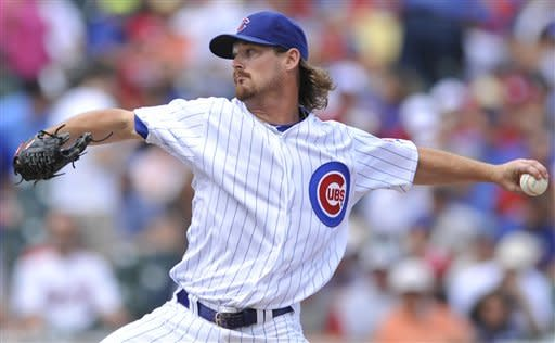 Chicago Cubs starter Travis Wood delivers a pitch against the St. Louis Cardinals in the first inning during a baseball game in Chicago, Friday, July 27, 2012. (AP Photo/Paul Beaty)