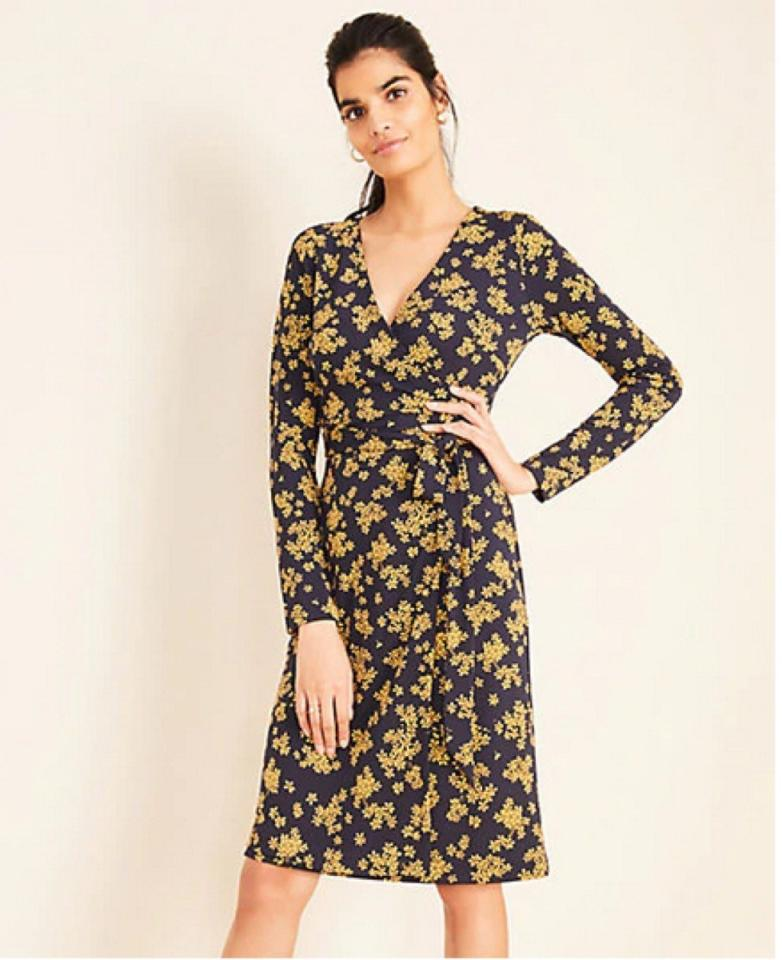 """Ann Taylor nails <a href=""""https://bestlifeonline.com/fall-dresses/?utm_source=yahoo-news&utm_medium=feed&utm_campaign=yahoo-feed"""" target=""""_blank"""">work basics like shift dresses</a> and tailored jackets, but the brand has become a bit more daring in recent years. For example, you can wear this Petaled Wrap Dress to the office with loafers and a blazer, then dress it up for after hours drinks by swapping in nude heels and a denim jacket. And now that you're all dressed up for work, why not dress up your desk, too? Check out these <a href=""""https://bestlifeonline.com/cute-office-decor/?utm_source=yahoo-news&utm_medium=feed&utm_campaign=yahoo-feed"""" target=""""_blank"""">15 Adorable Pieces of Office Décor That Will Actually Make You Want to Go To Work</a>.      <div class=""""buy-button-wrapper"""">                     <div class=""""detail"""">                                     <span class=""""price"""">$98</span>                                                     <span class=""""retailer"""">at Ann Taylor</span>                             </div>                 <a href=""""https://fave.co/31T7A58"""" rel=""""nofollow"""" target=""""_blank"""" class=""""buy-button """">Buy Now</a>     </div>"""