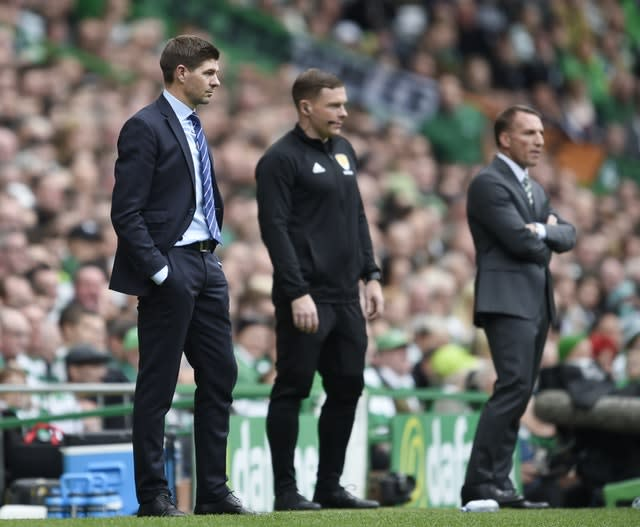 Gerrard (left) watched Rangers lose 1-0 to Brendan Rodgers' Celtic in his first Old Firm clash back in 2018