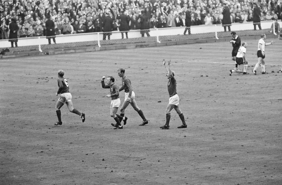 England 4 v West Germany 2, after extra time. England players left to right: Bobby Moore, Nobby Stiles, Jack Charlton and Bobby Charlton celebrate after the third goal, scored by Geoff Hurst. 30th July 1966.