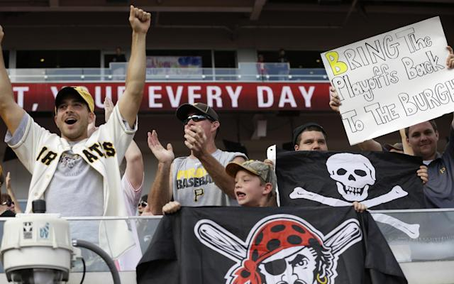 Pittsburgh Pirates fans celebrate after the Pirates defeated the Cincinnati Reds 8-3 in a baseball game, Saturday, Sept. 28, 2013, in Cincinnati. The two teams will play a wild card playoff game Tuesday in Pittsburgh. (AP Photo/Al Behrman)
