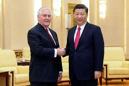 Chinese President Xi Jinping shakes hands with U.S. Secretary of State Tillerson before their meeting at at the Great Hall of the People