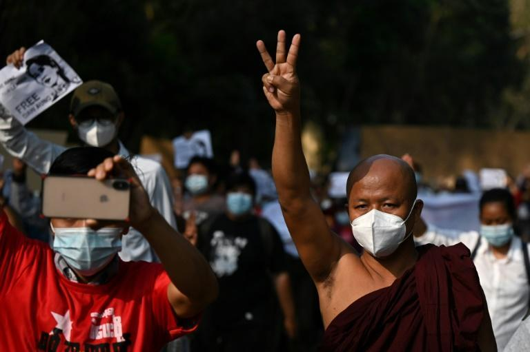 Many protesters flashed the three-finger salute from the 'Hunger Games' movies, which has been used as a symbol of resistance by Thailand's pro-democracy movement