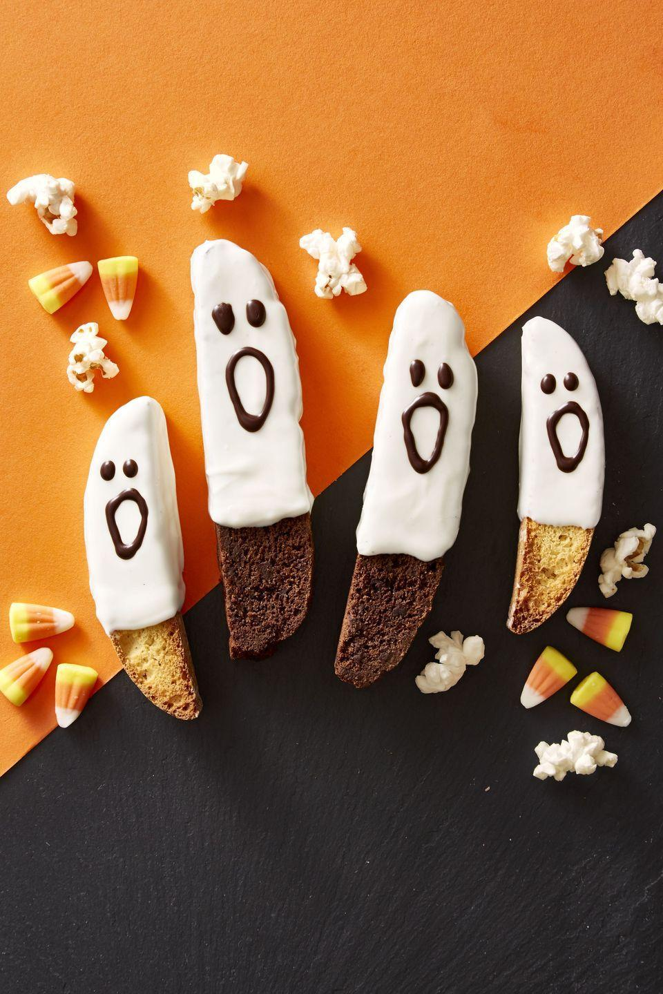 """<p>Dip store-bought biscotti into white, milk or dark chocolate for an instant dose of ghostly magic. <a href=""""https://www.goodhousekeeping.com/food-recipes/a46101/boo-scotti-recipe/"""" rel=""""nofollow noopener"""" target=""""_blank"""" data-ylk=""""slk:"""" class=""""link rapid-noclick-resp""""><br><em><br></em></a><a href=""""https://www.goodhousekeeping.com/food-recipes/a46101/boo-scotti-recipe/"""" rel=""""nofollow noopener"""" target=""""_blank"""" data-ylk=""""slk:Get the recipe for Boo-scotti »"""" class=""""link rapid-noclick-resp""""><em>Get the recipe for Boo-scotti »</em></a></p>"""
