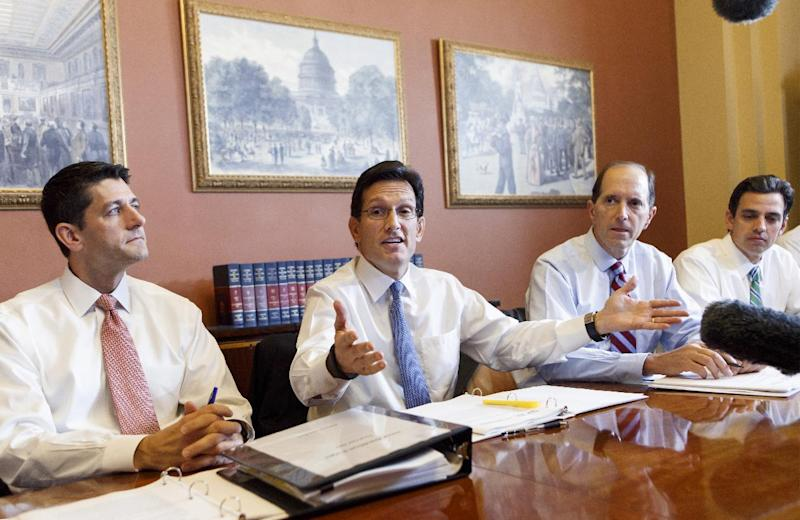 With the federal government out of money and out of time, House Majority Leader Eric Cantor, R-Va., center, meets with House GOP conferees as the Republican-controlled House and the Democrat-controlled Senate remain at an impasse, neither side backing down over Obamacare, Tuesday, Oct. 1, 2013, on Capitol Hill in Washington. From left are, House Budget Committee Chairman Rep. Paul Ryan, R-Wis., Cantor, House Ways and Means Committee Chairman Rep. Dave Camp , R-Mich., and Rep. Tom Graves, R-Ga. Graves led an effort with other emboldened conservatives that forced Speaker Boehner and the leadership to tie the money needed to keep the government running with defunding Obamacare. (AP Photo/J. Scott Applewhite)
