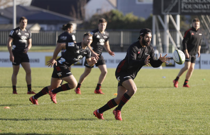 Crusaders Richie Mo'unga looks to catch the ball during a training session at Rugby Park in Christchurch, New Zealand, Wednesday, May 27, 2020. New Zealand's Super Rugby Aotearoa will start on June 13 in a new five-team, 10-week competition. (AP Photo/Mark Baker)