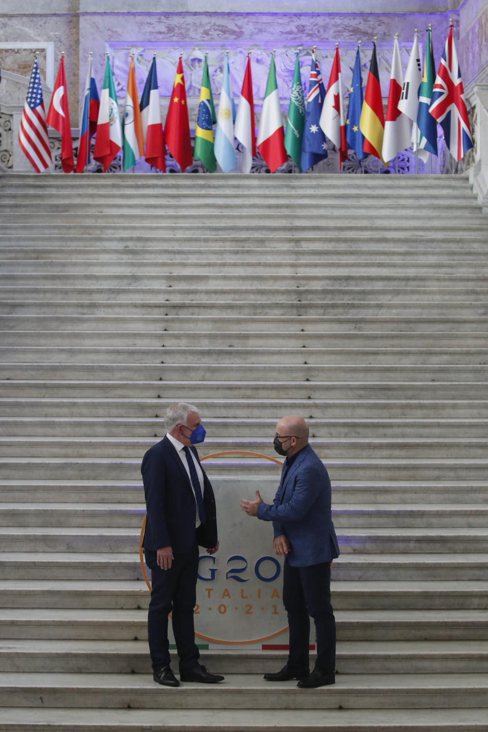 German undersecretary of environment Jochen Flasbarth, left, is welcomed by Italian Minister for Ecological Transition Roberto Cingolani as he arrives at Palazzo Reale in Naples, Italy, Thursday, July 22, 2021, to take part in a G20 meeting on environment, climate and energy. (AP Photo/Salvatore Laporta)