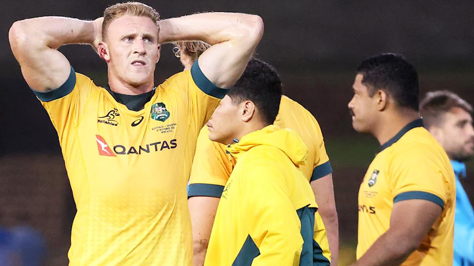 Wallabies players look on after their 15-15 draw with Argentina. (Photo by DAVID GRAY/AFP via Getty Images)