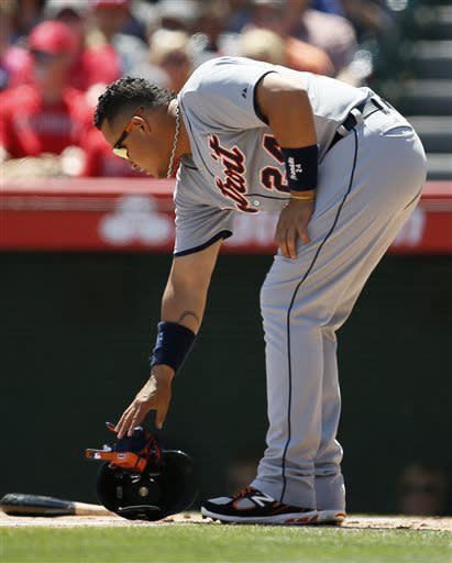 Detroit Tigers' Miguel Cabrera takes off his batting gloves after striking out to end the top of the first inning of a baseball game against the Los Angeles Angels on Saturday, April 20, 2013, in Anaheim, Calif. (AP Photo/Danny Moloshok)