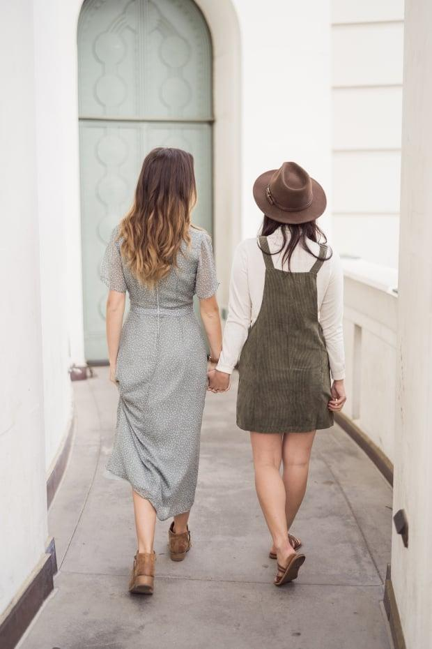 Alexandra and Samantha Conway have spent thousands of dollars on IVF procedures. They also had to pay for their initial consultation because the province only covers that for opposite-sex couples.   (Dipan Desai Photography - image credit)