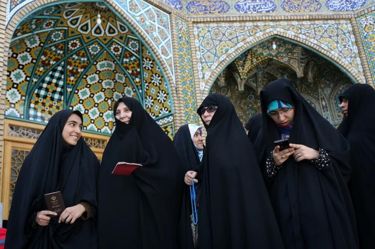 Women prepare to vote in Iran's presidential election in the Shiite Muslim holy city of Qom on May 19, 2017