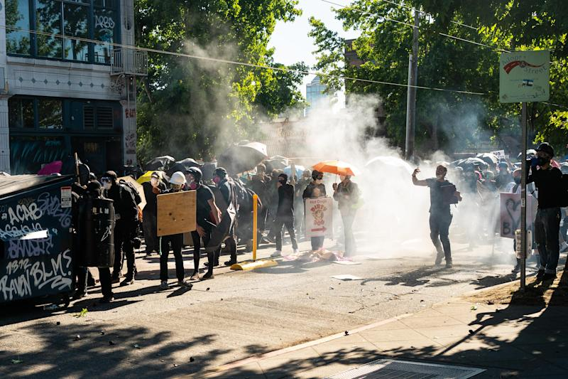 Demonstrators use skip bins and shields for protection from police during a protest on Saturday in Seattle. Source: Getty Images