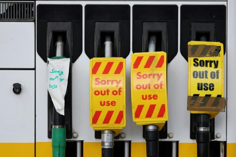 Britain has insufficient lorry drivers to transport petrol to the fuel pumps (AFP/Adrian DENNIS)